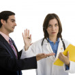 Man apologizing to female doctor — Stock Photo