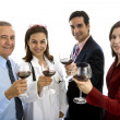 Doctor toasting with administration staff — Stock Photo