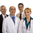 Doctors with businessmen — Photo
