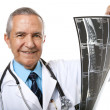 Senior male doctor holding xrays — Stock Photo