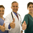 Nurses and doctor gesturing thumbs up — Stock Photo