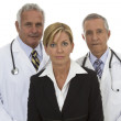 Serious senior doctors and businesswoman — Stock Photo