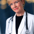 Mature woman doctor with stethoscope — Stock Photo
