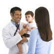Doctor giving baby check up — Stock Photo