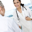 Female doctor meeting senior man — Foto Stock