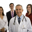 Doctor with businesswomen and businessman — Stock Photo