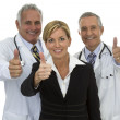 Doctors and businesswoman thumbs up — Stock Photo