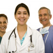 Doctor with male and female in scrubs — Stockfoto