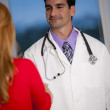 Doctor shaking hands with patient — Stock Photo