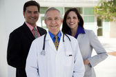 Male doctor with businessman and businesswoman — Stock Photo
