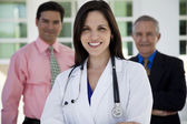 Female doctor with two businessmen — Stock Photo