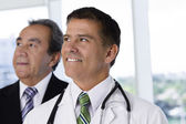 Businessman and male doctor — Stock Photo