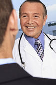 Hispanic doctor meeting male — Stock Photo