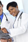 African female doctor holding x-ray — Stock Photo