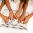 Girls typing on laptop — Stock Photo