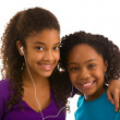 Two teenage girls listening to music — Stock Photo