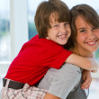 Stock Photo: Girl with boy on piggy back