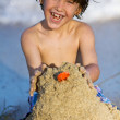 Boy making sand castle — Stock Photo