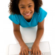 Stock Photo: Teenage girl typing on computer