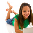 Teenager laying with computer — Foto de Stock