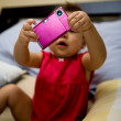 Little girl with digital camera — Foto Stock