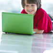 Smiling boy with laptop — Stock Photo