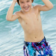 Stock Photo: Boy wearing goggle and swimming trunks