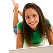 Stock Photo: Girl typing on laptop