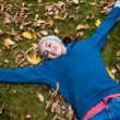 Adolescent laying on ground — Stock Photo