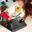 Stock Photo: Boy and girl using laptops
