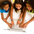 Girls sharing a computer — Stock Photo