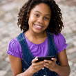 African girl sending text message — Stock Photo