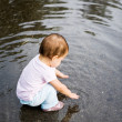 Little girl investigating water — Stock Photo