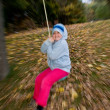 Little girl swinging — Stock Photo #34715707