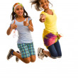 Girls jumping for joy — Stockfoto