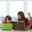 Brother and sister with laptops — Stock Photo
