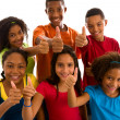 Multi-ethnic group thumbs up — Stockfoto