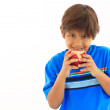Boy biting red apple — Stock Photo