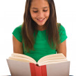 Girl reading book — Stockfoto