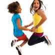 Girls dancing and jumping — Stock Photo