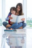 Girl reads book to boy — Stock Photo