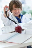 Boy dress up as doctor — Stock Photo