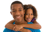 Brother and sister hugging — Stock Photo