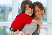 Girl with boy on piggy back — Stock Photo