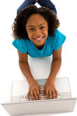 Teenage girl typing on computer — Stock Photo