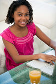 African teenager with laptop — Stock Photo