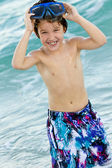 Boy wearing goggle and swimming trunks — Stock Photo