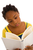 Teenager reading book — Stock Photo