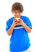 Smiling boy biting apple — Stock Photo