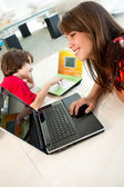 Boy and girl using laptops — Stock Photo